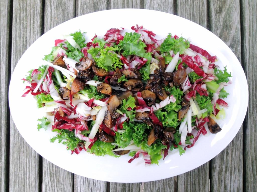 Salads, green, bitter greens with sauteed mushrooms and warm rosemary vinaigrette 1