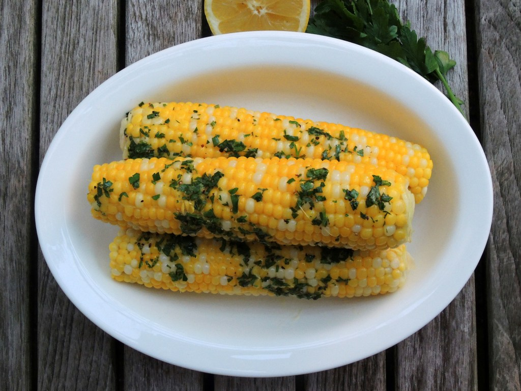 Vegetables, corn on the cob, boiled, with maitre d'hotel butter
