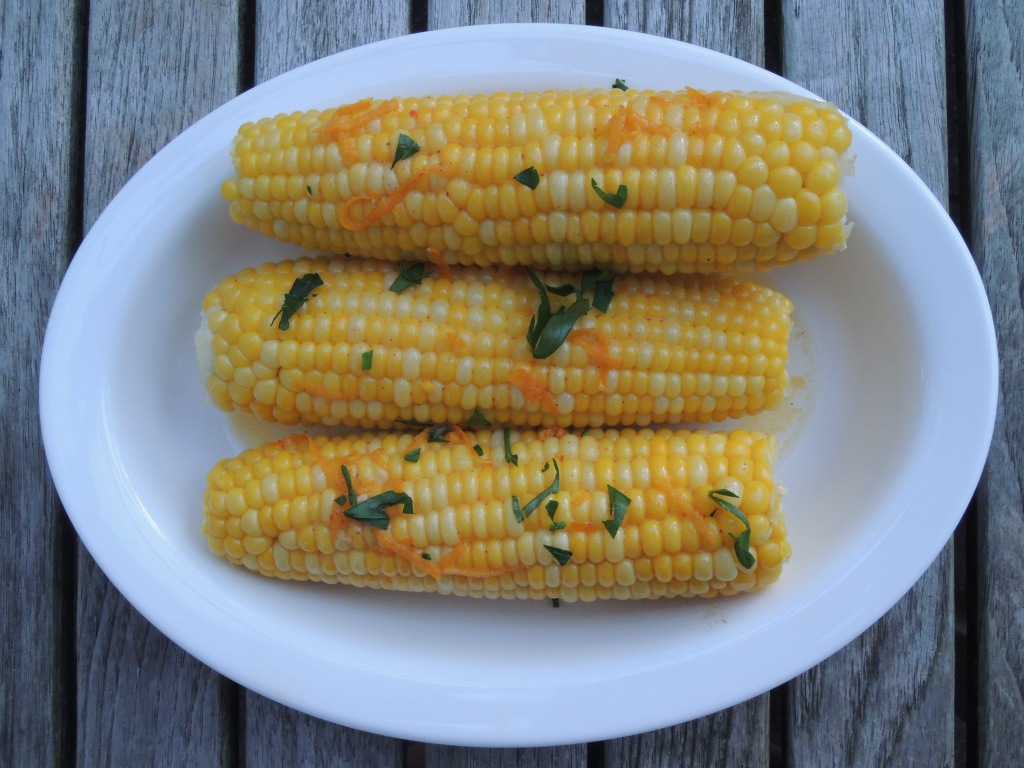 Vegetables, corn on the cob, boiled, with orange butter