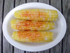 Vegetables, corn on the cob, boiled, with tomato butter 1