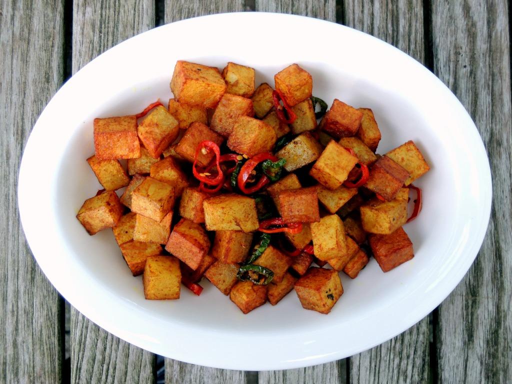 Vegetables, potatoes, fried, peele aloo (Indian turmeric fried potatoes) 1