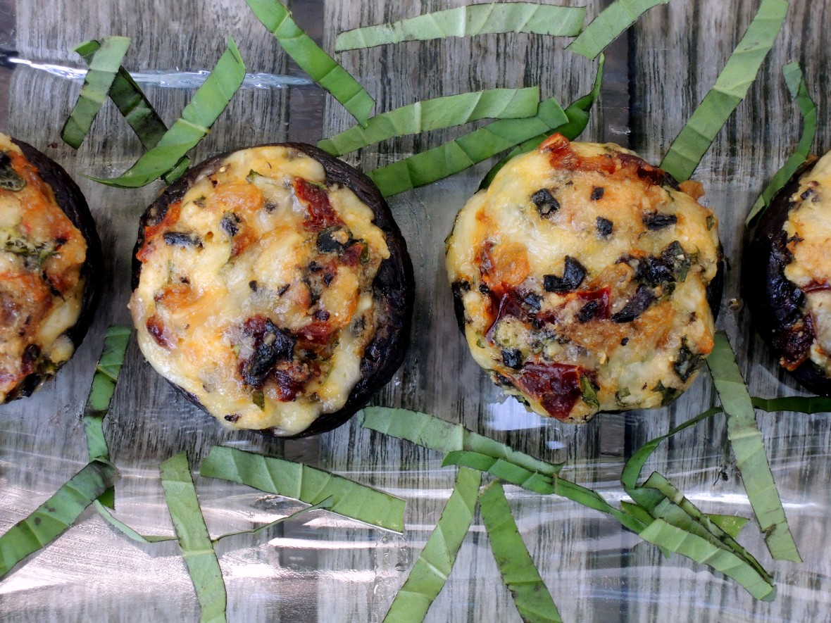 Appetizers, mushrooms, stuffed mushroom caps with Parmesan and sun dried tomatoes 2