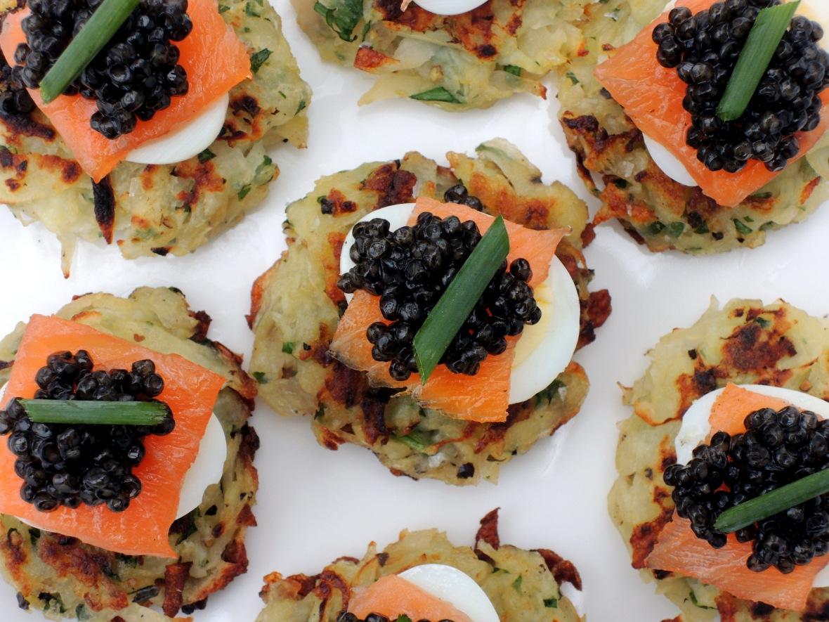 Appetizers, eggs, quail eggs, potato latkes with smoked salmon, quail eggs and sevruga caviar 2